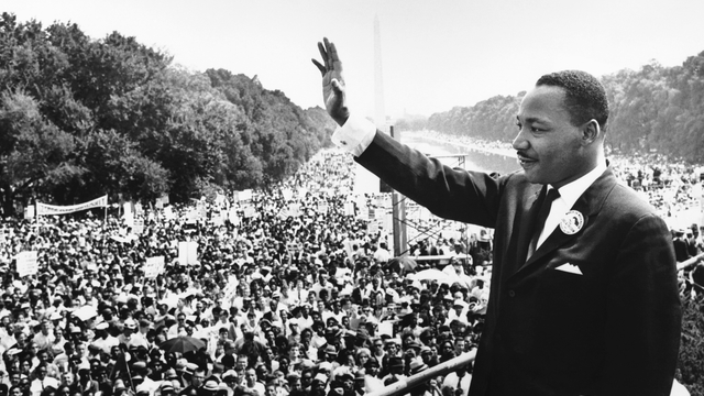 Martin Luther King with arm outstretched