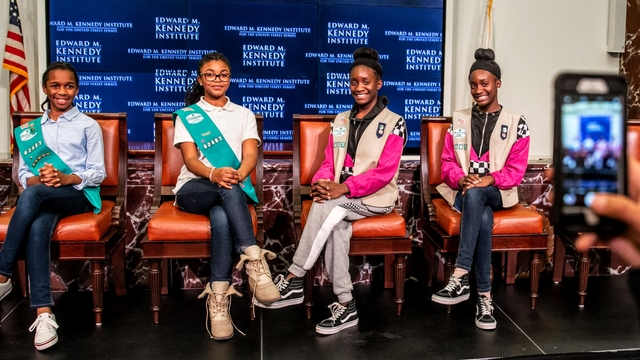 Girls govern participants on stage