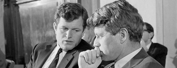 Sen. Kennedy confers with his brother, Robert F. Kennedy.