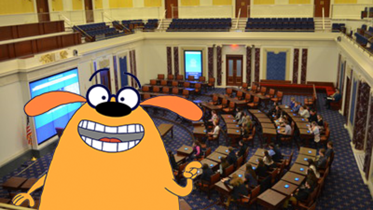 Ruff Ruffman, a cartoon dog from WGBH's FETCH! with Ruff Ruffman is interposed over the museum's reproduction Senate Chamber. This is where the educational Future Senator program, aimed at Grades Three through Six, takes place.