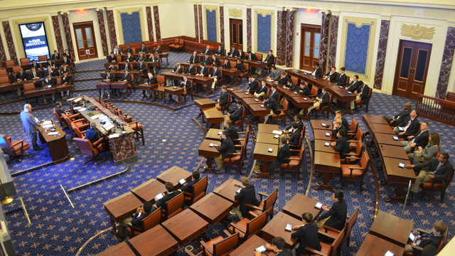 Roxbury Latin School during a Senate Immersion Module in the reproduction Senate Chamber. Picture taken from gallery.