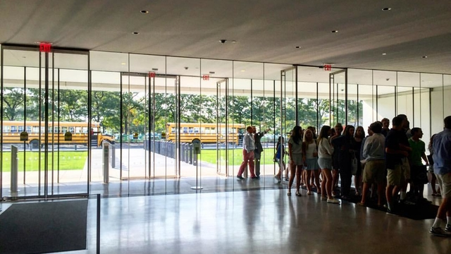 Student congregate in the museum's sleek marble lobby after drop off from school buses