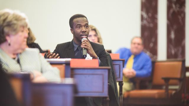 Man speaking in Senate Chamber