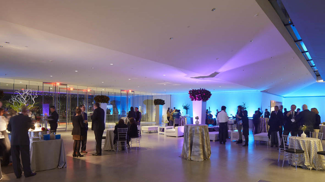 Guests mingle in the museum's sleek, well decorated lobby during an event